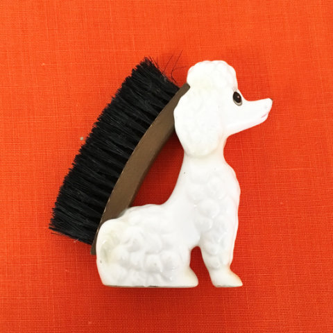 poodle clothes brush , kitsch china
